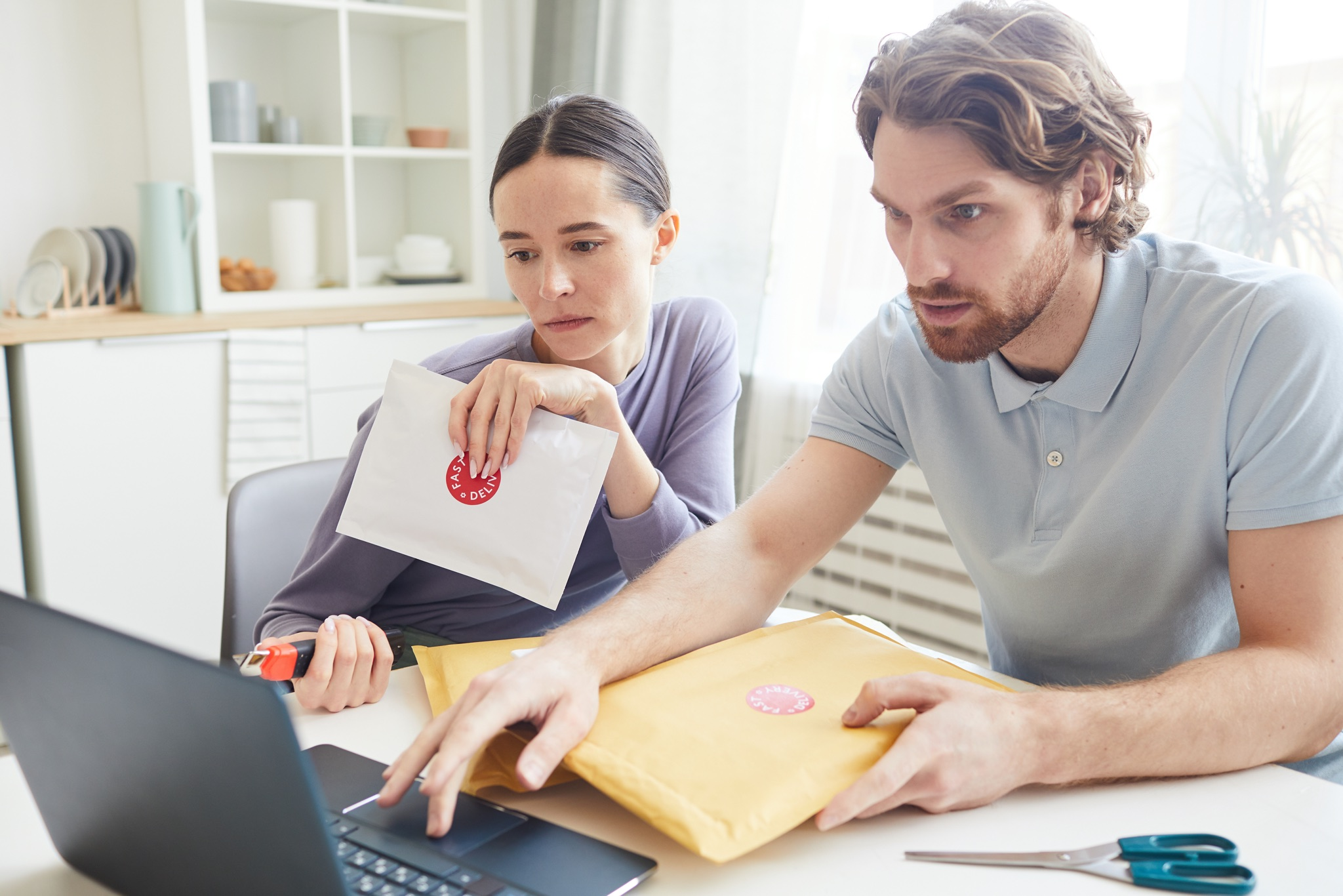 Couple checking invoice email
